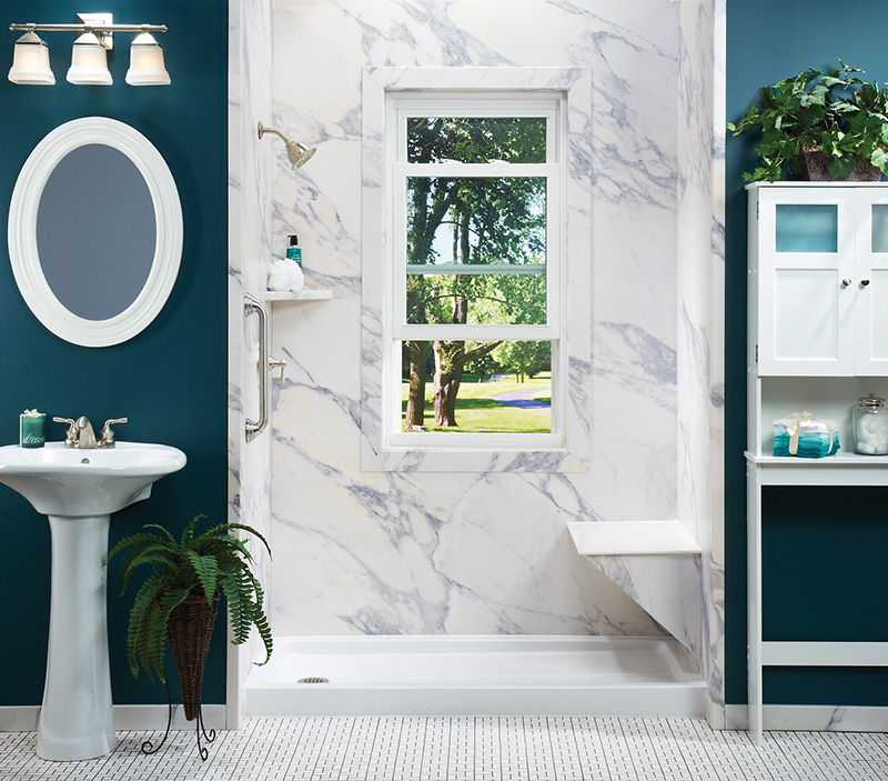 teal bathroom with shower and granite look walls and seat