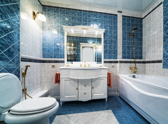 striking blue and white tile in an elegant remodeled bathroom
